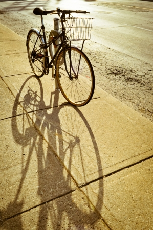 Bicycle locked to the rack and its shadow, Toronto