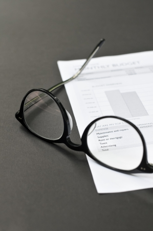 Balance sheet and eye glasses on the table