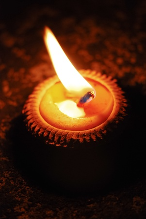 Yellow candle in terracotta pot lit on the occasion of Loy Krathong festival, Thailand photo
