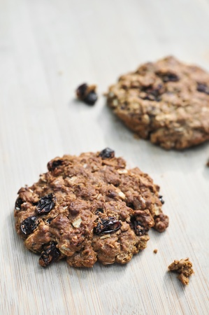 Fresh baked homemade oatmeal raisin cookies on woodem board  brown colour from sugar  Stock Photo