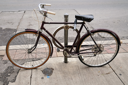 locked up: An old bicycle locked up on the street in Toronto