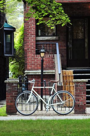 Bicycle parked near steel fence on the street in Toronto