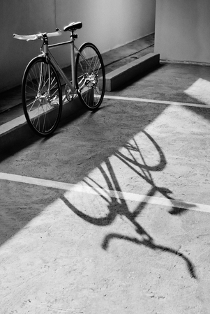 Bike and shadow in black and white
