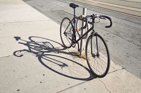Bicycle locked up on the street in Toronto