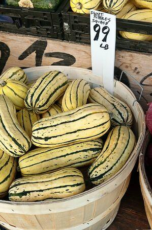 Sweet potatoes squash  or delicata squash at the farmers market