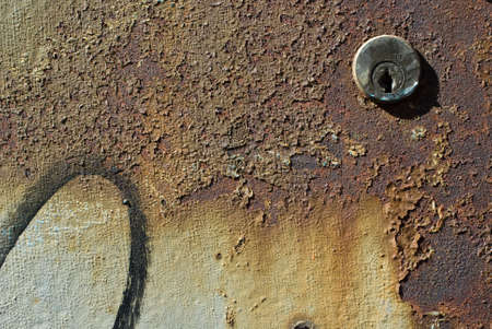 Keyhole in a rusted metal plate photo