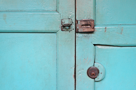 Aged steel cupboard safety padlock door latch photo