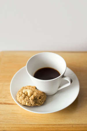 Coffee cup and cookies on wooden table background Stock Photo