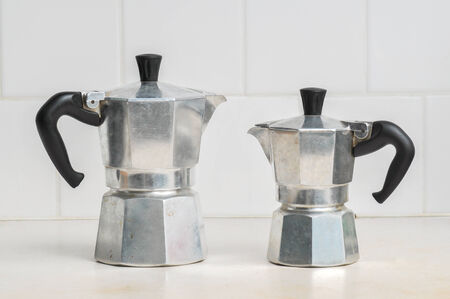 with coffee maker: Italian coffee maker (moka pot) on kitchen countertop