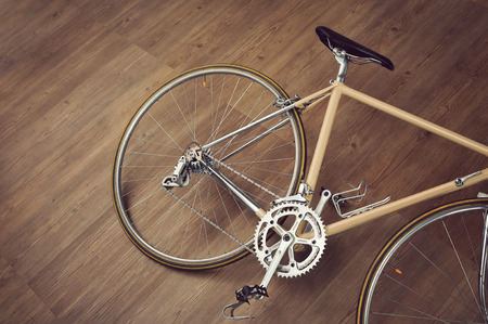 Vintage road bicycle on wooden floor