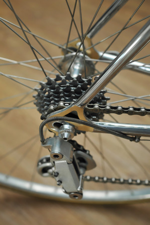 Bicycles detail view of rear wheel with chain & sprocket photo