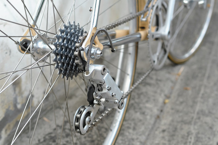 sprocket: Bicycles detail view of rear wheel with chain & sprocket Stock Photo