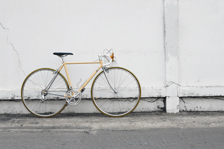 Vintage road bicycle leaning on white wall Stock Photo