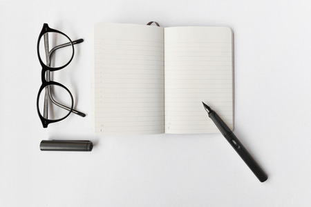 diary: Blank diary, pen, and glasses on white background