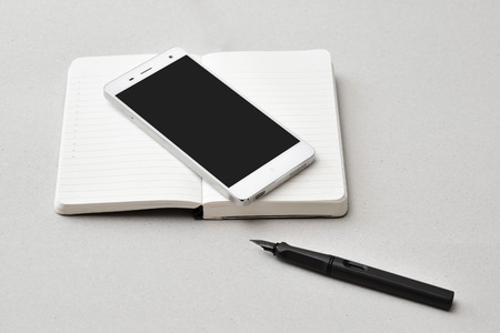Smart phone, notebook, and pen, isolated
