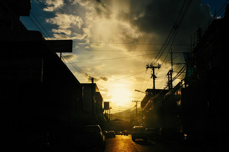 Sunset behind silhouette of small town