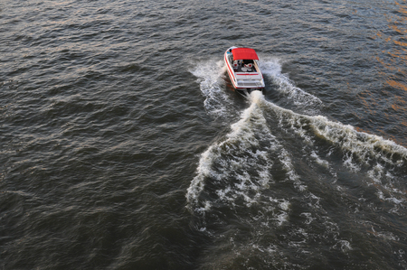 Speed Boat on a River