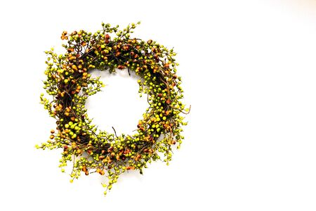 A wreath used on holidays on a white background with extra space for text Imagens