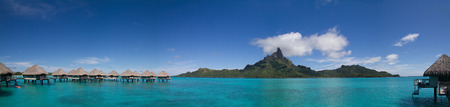 otemanu: Mt. Otemanu with Overwater Bungalows in Bora Bora, French Polynesia Editorial