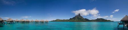 otemanu: Mt. Otemanu with Overwater Bungalows in Bora Bora, French Polynesia Editorial