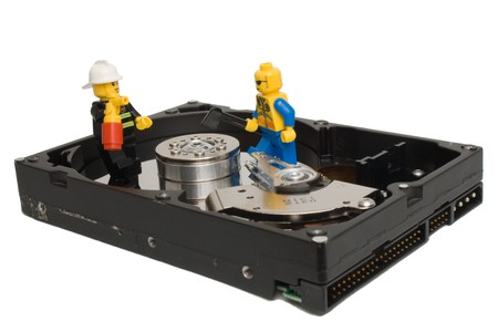 diskdrive: Men working on hard drive Stock Photo