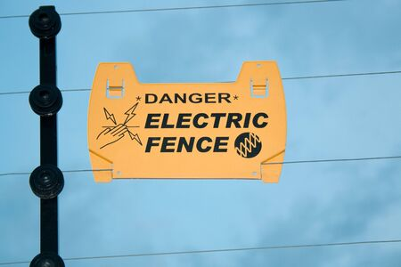 electric wires: Warning on electric fence to prevent electric shock