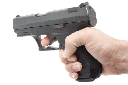 finger on trigger: This is a hand holding a gun shooting