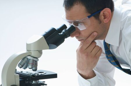 A scientist and his microscope
