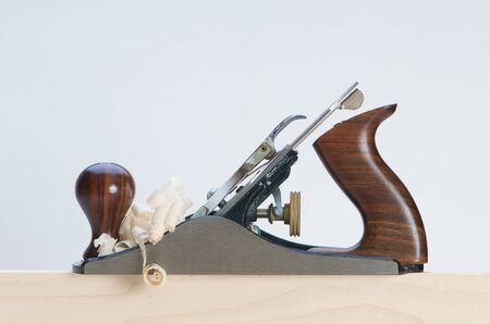 A hand plane and wood shavings