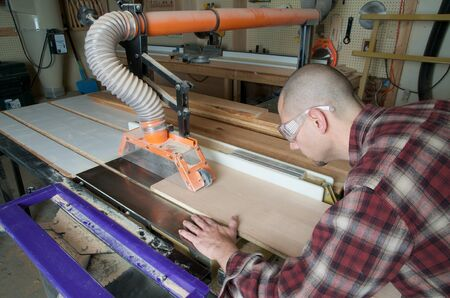 Woodworker working on table saw Stock fotó