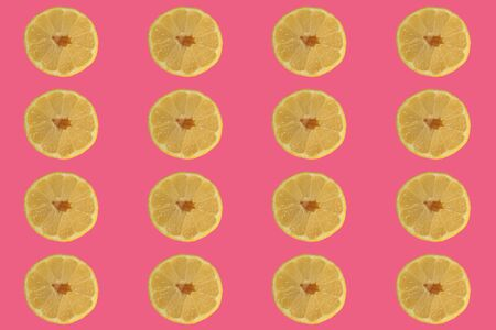 Sliced ?? lemon on a red background, concept for recipes, blog or cookbook