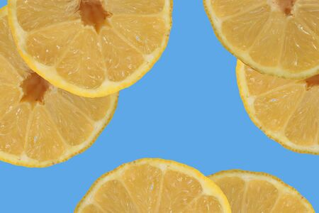Sliced ?? lemon on a blue background, concept for recipes, blog or cookbook
