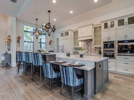 Split level kitchen island in luxury Florida home 写真素材