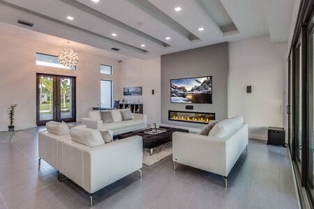 Gorgeous great room connected to front entryway with high ceilings Stock Photo