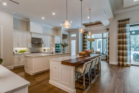 Beautifully large white kitchen with double islands