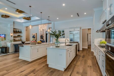 Spacious white kitchen with two islands