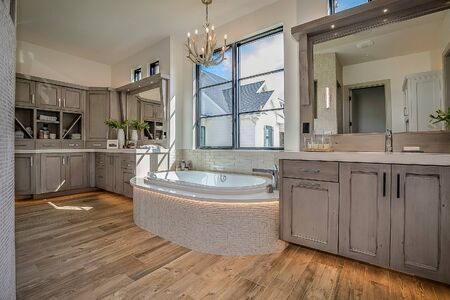 Large soaking tub with mosaic tile and a great view