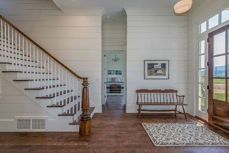 Beautiful front entryway of newly built farmhouse