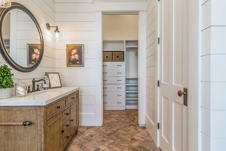 White and brown bathroom with shiplap walls
