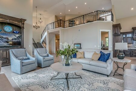 Comfortable great living room with front entry and upstairs loft in the distance
