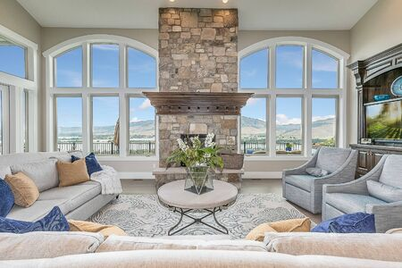 Bright great room with views of the mountains and lake