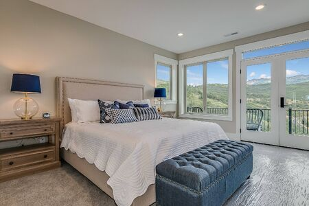 Lovely bedroom with french doors leading out to deck