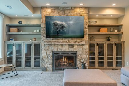 Stone fireplace in upscale home in the mountains Archivio Fotografico