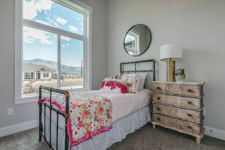 Lovely girls bedroom with large windows