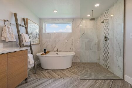 Gorgeous master bathroom with shared shower and bathtub space