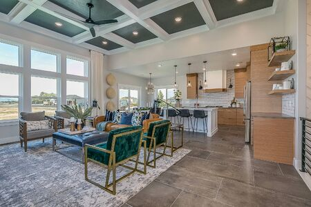 Great room with beautiful coffered ceiling in open floor plan house