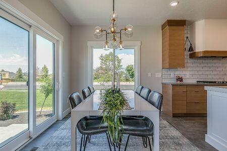 Modern dining area next to spacious kitchen
