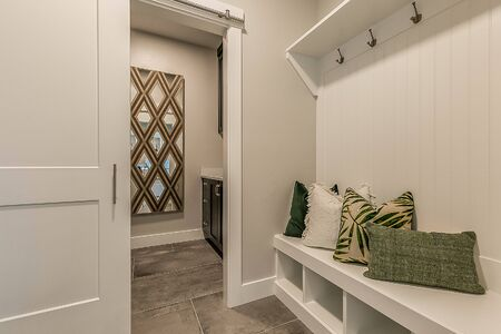 Clean newly built home with white mud room