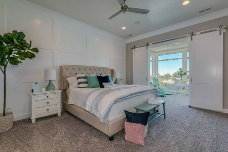 Cheerful feel to this master bedroom with connected sunroom