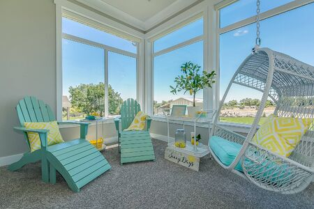 Sunroom off of master bedroom with mint green furniture Stock Photo